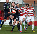 Accies Stephen Hendrie blocks Raith's Greig Spence's shot.