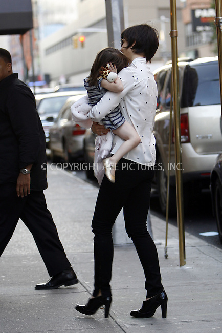 WWW.ACEPIXS.COM . . . . .  ....October 10 2008, New York City....Suri Cruise decides that she has had enough attention from photographers and buries her face into her mother, actress Katie Holmes as they return to their Manhattan apartment on October 10 2008 in New York City....Please byline: NANCY RIVERA- ACE PICTURES.... *** ***..Ace Pictures, Inc:  ..tel: (646) 769 0430..e-mail: info@acepixs.com..web: http://www.acepixs.com