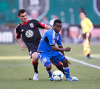 Alain Rochat (25) of D.C. United keeps close tabs on Shea Salinas (6) of the San Jose Earthquakes during a Major League Soccer game at RFK Stadium in Washington, DC.  D.C. United defeated San Jose Earthquakes, 1-0.