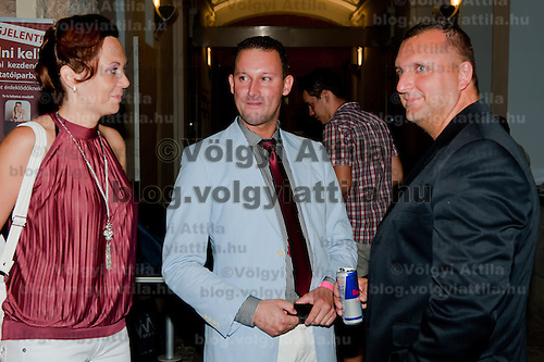 Hungarian celebrity Alekosz (C) and V Laci (R) known from a reality show attend a party in Budapest, Hungary on August 31, 2011. ATTILA VOLGYI