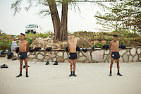 14 February, 2013 - Sihanoukville. Deminers from the Cambodian Mine Action Center (CMAC) practice stretching on the shore of Independence Beach - Sihanoukville. © Thomas Cristofoletti / Ruom