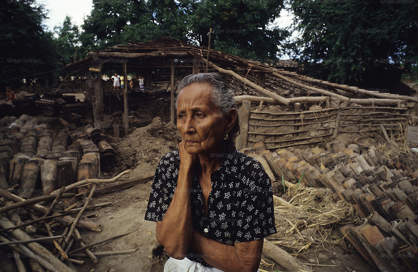 Central America, Honduras, near Choluteca. Devastation in the aftermath of Hurricane Mitch. High winds and flooding. Soil erosion caused by deforestation. Women in front of her home. Houses and infrastructure destroyed.