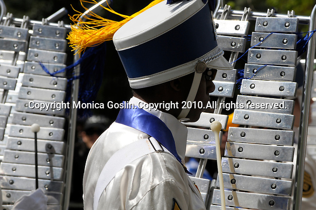 Greek Parade in New York City. A boy in a high school marching band, playing the xylophone, marches in the Greek Parade in New York City.