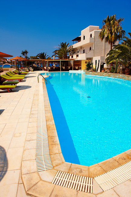 The swimming pool of the Corali Hotel on the harbour of Ormos, Ios, Cyclades Islands, Greece