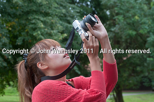 Taking photos of the front of the main building, reunion for Summerhill School's 90th birthday celebrations.