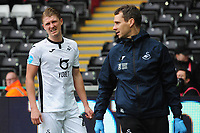 George Byers of Swansea City goes off injured during the Sky Bet Championship match between Swansea City and Derby County at the Liberty Stadium in Swansea, Wales, UK. Saturday 08 February 2020