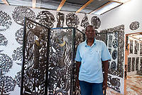 Haiti, Port-au-Prince. Noailles, the Village of Iron Craftsmen in Croix-des-Bouquets, an old sugar plantation, is now Haiti's iron center with 70 workshops, nearly 300 artists and impacts 7000 homes. The artists create iron work sculptures from oil drums. Guerline Prophete. MR