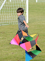 NWA Democrat-Gazette/BEN GOFF @NWABENGOFF<br /> Asher Mostyn, 6, of Rogers tries to get his kite in the air on Sunday Sept. 13, 2015 while flying with his family at Memorial Park in Bentonville.