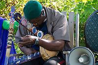Traditional healer and musician playing at harvest festival, ME