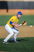 Delaware Blue Hens third baseman Diaz Nardo (27) fields a ground ball against the Georgetown Hoyas at Wake Forest Baseball Park on February 13, 2015 in Winston-Salem, North Carolina.  The Blue Hens defeated the Hoyas 3-0.  (Brian Westerholt/Four Seam Images)