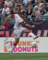 DC United forward Hamdi Salihi (9) shoots the ball. In a Major League Soccer (MLS) match, DC United defeated the New England Revolution, 2-1, at Gillette Stadium on April 14, 2012.