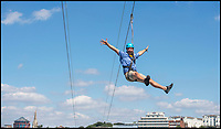 BNPS.co.uk (01202 558833)<br /> Pic: PhilYeomans/BNPS<br /> <br /> Delighted - Bournemouth zip wire manger Joe Potter says 'Perfect weather this year'<br /> <br /> The summer heatwave is leading to a 'bumper year' for tourism at Britain's premier seaside resort.<br /> <br /> Over 100,000 people are visiting Bournemouth, Dorset, every weekend and hotels are full to capacity, with restaurants packed and huge queues at ice cream stalls.<br /> <br /> Seafront kiosks are selling out of parasols and sun cream, while one bike hire company has reported a 50 per cent increase in business.