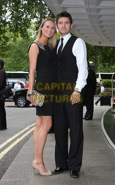CLARE HARDING & TOM CHAMBERS .Attending the English National Ballet Summer Party, The Dorchester hotel, Park Lane, London, England, UK,.15th June 2010.arrivals full length black dress waistcoat white shirt suit tie beige nude shoes patent clutch bag claire couple .CAP/ROS.©Steve Ross/Capital Pictures.