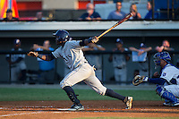 Rafelin Lorenzo (8) of the Princeton Rays follows through on his swing against the Burlington Royals at Burlington Athletic Stadium on June 24, 2016 in Burlington, North Carolina.  The Rays defeated the Royals 16-2.  (Brian Westerholt/Four Seam Images)