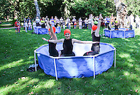 2016 09 18<br /> Pictured: Performers with synchronised swimming display in empty paddling pools, The Great Pyjama Picnic, Bute Park, Cardiff.Sunday 18 September 2016<br /> Re: Roald Dahl's City of the Unexpected has transformed Cardiff City Centre into a landmark celebration of Wales' foremost storyteller, Roald Dahl, in the year which celebrates his centenary.