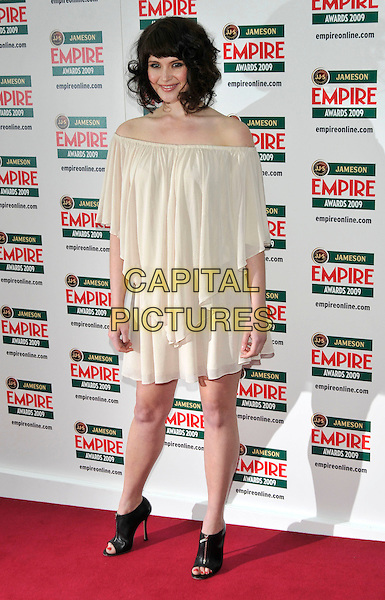 GEMMA ARTERTON .Arrivals - Jameson Empire Awards 2009 at the Grosvenor House Hotel, London, England, UK, March 29th 2009..film magazine full length cream dress off the shoulder blouson ruffle layered beige black booties open toe shoe boots  zips shoes .CAP/PL.©Phil Loftus/Capital Pictures