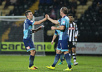 Matt Bloomfield of Wycombe Wanderers hands Garry Thompson of Wycombe Wanderers the captains armband as he is replaced during the Sky Bet League 2 match between Notts County and Wycombe Wanderers at Meadow Lane, Nottingham, England on 10 December 2016. Photo by Andy Rowland.