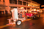 Recreational Railroad Coalition's speeder in Sutter Creek's annual Parade of Lights Christmas parade downtown on a rainy night in the  Mother Lode of Calif.