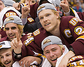 Scott Kishel (Duluth - 6), Mike Montgomery (Duluth - 24) - Keegan Flaherty (Duluth - 14), Aaron Crandall (Duluth - 31) - The University of Minnesota-Duluth Bulldogs celebrated their 2011 D1 National Championship win on Saturday, April 9, 2011, at the Xcel Energy Center in St. Paul, Minnesota.