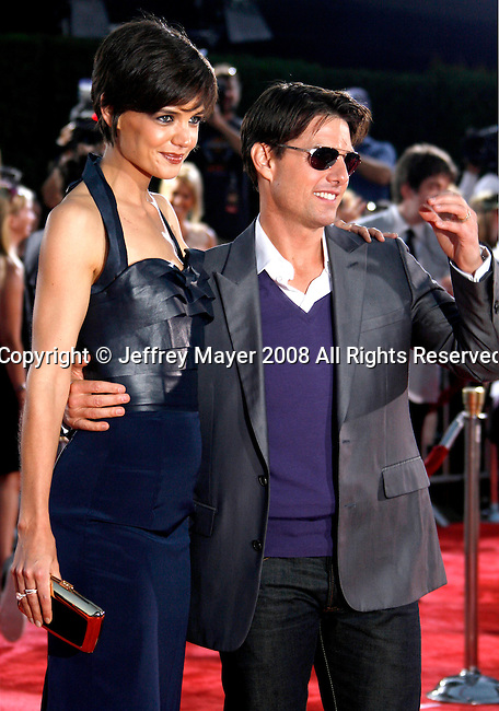"""Actor Tom Cruise and Actress Katie Holmes arrive at the Los Angeles Premiere Of """"Tropic Thunder"""" at the Mann's Village Theater on August 11, 2008 in Los Angeles, California."""