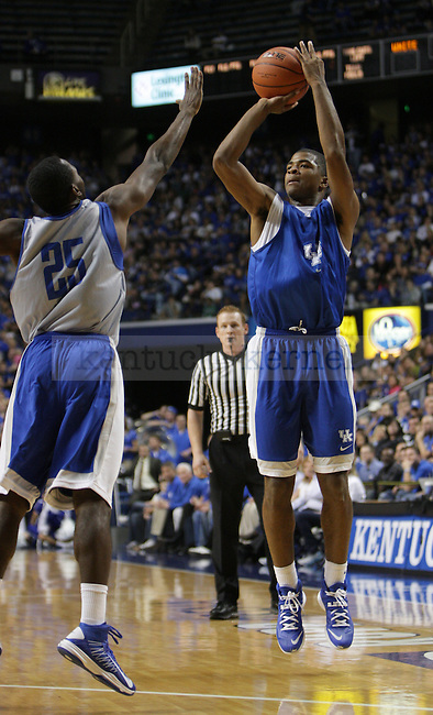 Kentucky Wildcats guard Aaron Harrison (2) jumps to shoot the ball during the first half of the Blue-White scrimmage at Rupp Arena in Lexington, Ky., on Tuesday, October 29, 2013. Photo by Tessa Lighty | Staff