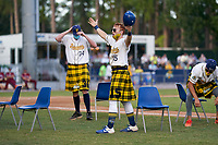 Savannah Bananas Nick Clarno (15) motions to the crowd for an on field dance promotion during a Coastal Plain League game against the Macon Bacon on July 15, 2020 at Grayson Stadium in Savannah, Georgia.  Savannah wore kilts for their St. Patrick's Day in July promotion.  (Mike Janes/Four Seam Images)