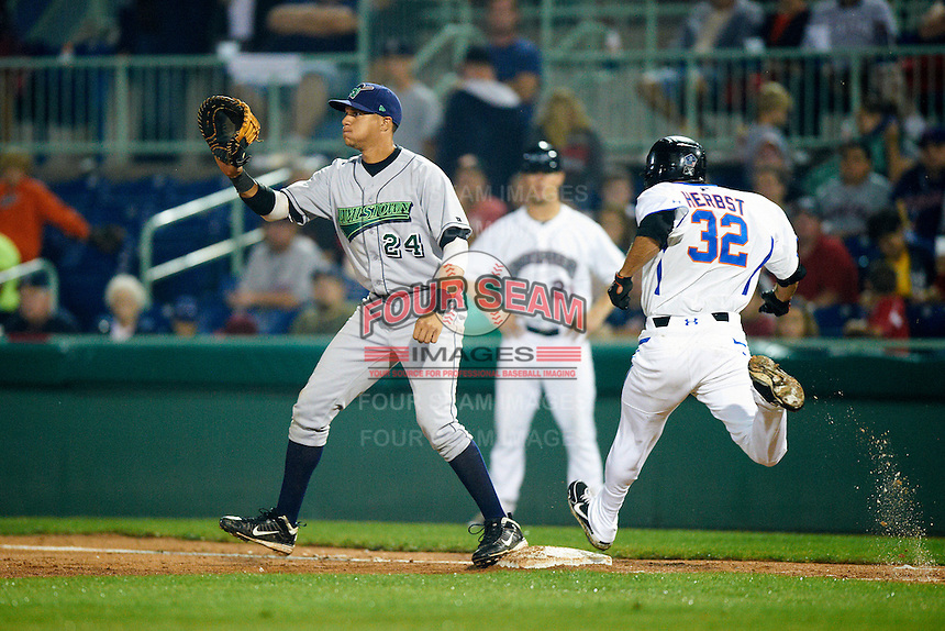Jamestown Jammers first baseman Viosergy Rosa #24 takes a throw as Lucas Herbst #32 gets to first during the NY-Penn League All-Star Game at Eastwood Field on August 14, 2012 in Niles, Ohio.  National League defeated the American League 8-1.  (Mike Janes/Four Seam Images)