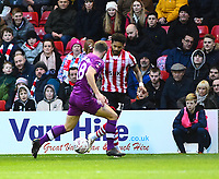 Lincoln City's Bruno Andrade battles with  Carlisle United's Jack Sowerby<br /> <br /> Photographer Andrew Vaughan/CameraSport<br /> <br /> The Emirates FA Cup Second Round - Lincoln City v Carlisle United - Saturday 1st December 2018 - Sincil Bank - Lincoln<br />  <br /> World Copyright © 2018 CameraSport. All rights reserved. 43 Linden Ave. Countesthorpe. Leicester. England. LE8 5PG - Tel: +44 (0) 116 277 4147 - admin@camerasport.com - www.camerasport.com