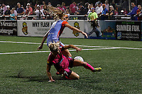 Western New York Flash midfielder McCall Zerboni (7) id defended by Houston Dash forward Janine Beckie (11) during recent NWSL match
