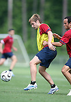 Bobby Convey (center) is defended by Landon Donovan (r) on Sunday, May 14th, 2006 at SAS Soccer Park in Cary, North Carolina. The United States Men's National Soccer Team held a training session as part of their preparations for the upcoming 2006 FIFA World Cup Finals being held in Germany.
