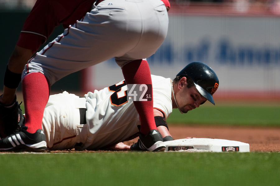 19 April 2009: San Francisco Giants' Aaron Rowand makes it back safely at first base during the San Francisco Giants' 2-0 win  against the Arizona Diamondbacks at AT&T Park in San Francisco, CA.