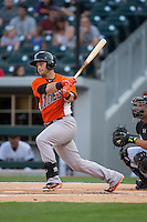 Christian Walker (22) of the Norfolk Tides follows through on his swing against the Charlotte Knights at BB&T BallPark on April 9, 2015 in Charlotte, North Carolina.  The Knights defeated the Tides 6-3.   (Brian Westerholt/Four Seam Images)