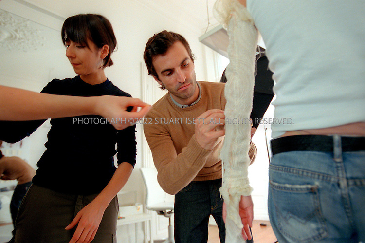 10/2/2005--Paris, France..Nicolas Ghesquiere, creative director at Balenciaga, working at the company's Paris studios on the Autumn/Winter 2005 collection that will be shown this week in Paris. Born in Provence, France in 1971, Ghesquière began to exhibit his design talents at the age of eleven. In 1997, at the age of 25, he was the surprise choice to head Balenciaga..Photograph By Stuart Isett.All photographs ©2005 Stuart Isett.All rights reserved.