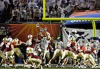 FSU's Gary Cismesia kicks an extra point following Willie Reid's record-setting 87 yard punt return in the second quarter of the 2006 FedEx Orange Bowl Game.  Cismesia's kick tied the game at 7-7.