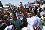 People chant slogans during a protest calling on President Mahmoud Abbas to end financial sanctions on Palestinians in Gaza, in Gaza City, on June 18, 2018. Demonstrators called Fatah and Hamas movements to reconcile. Photo by Mahmoud Ajour