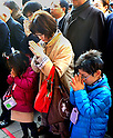 January 4, 2012, Tokyo, Japan - A Japanese mother and her children make their wishes at Kanda Shrine in downtown Tokyo on Wednesday, January 4, 2012. Thousands of people turned out to celebrate the new year and make their wishes in a traditional rite at the Shinto shrine which dates back 1,270 years. (Photo by Natsuki Sakai/AFLO) [3615] -mis-