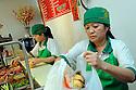 Preparing banh min at Dong Phuong Oriental Restaurant and Bakery