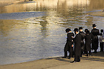 Israel, Tel Aviv, Tashlich prayer of the Premishlan congregation by the Yarkon River