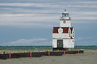 The Kewaunee Pierhead Lighthouse sits lonley against a autumn storm