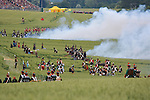 Battle of the attack of the french army show of the bicentenary of the Battle of Waterloo in the Farm of Hougoumont. Waterloo, 19 june 2015, Belgium