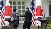 Japan's Prime Minister Shinzo Abe and US President Barack Obama depart from a joint press conference at The White House in Washington DC for a State Visit, April 28, 2015. Credit: Chris Kleponis / CNP