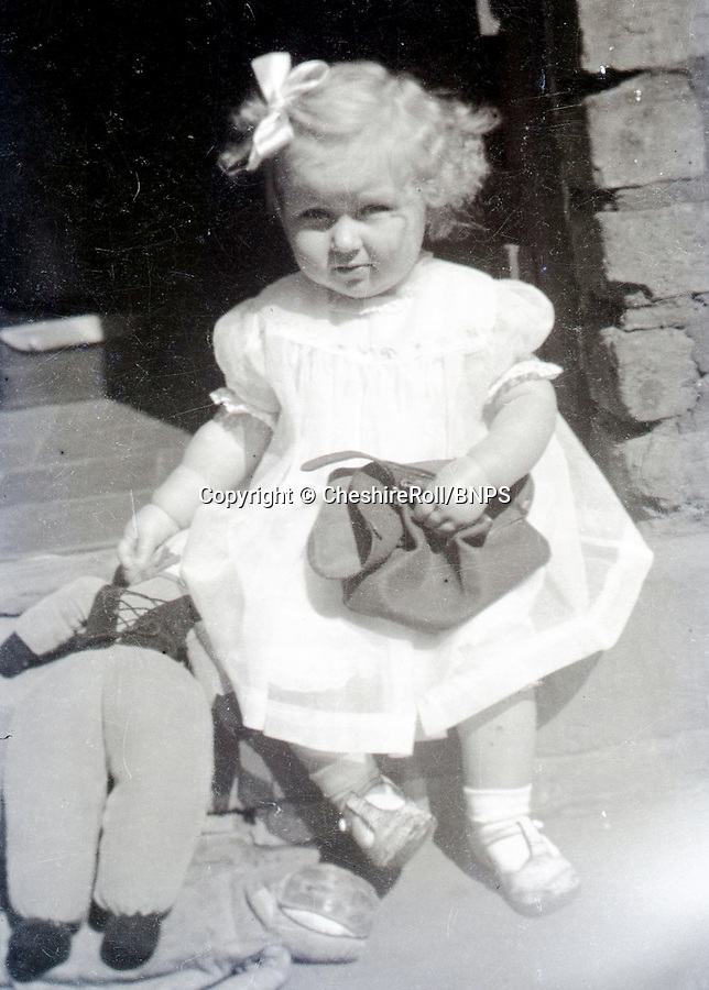 BNPS.co.uk (01202 558833)<br /> Pic CheshireRoll/BNPS<br /> <br /> PICTURED: June as a child<br /> <br /> A poignant poem written by a British prisoner of war pining for the baby daughter he had never met has come to light 75 years later.<br /> <br /> Lance Corporal Frank Kenyon treasured a black and white photo of his newborn daughter June that his wife Doris sent to him while he languished in a German prison camp.<br /> <br /> It inspired him to turn to poetry to cope with being parted from his family during the two-and-a-half years he was a PoW for.