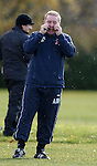 Ally McCoist wiping away the tears after a good laugh at training