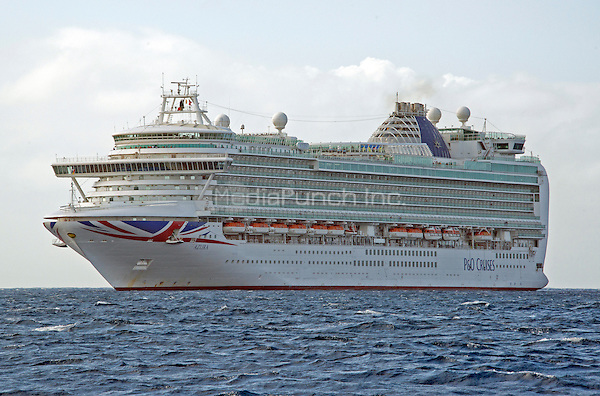 P&amp;O Azura, which carries 3,100 Passengers and1,250 Crew rests in the harbor of George Town, Grand Cayman in the Cayman Islands on Tuesday, December 20, 2016.  P&amp;O Cruises are operated by Carnival UK and owned by Carnival Corporation &amp; plc.<br /> Credit: Ron Sachs / CNP /MediaPunch