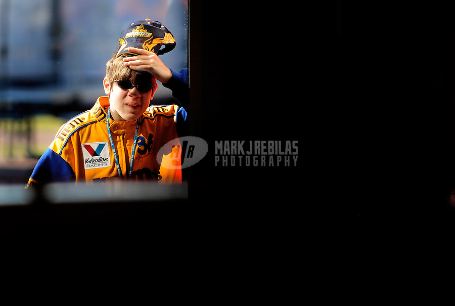 Feb 07, 2009; Daytona Beach, FL, USA; A NASCAR Sprint Cup Series fan peeks into the garage during practice for the Daytona 500 at Daytona International Speedway. Mandatory Credit: Mark J. Rebilas-