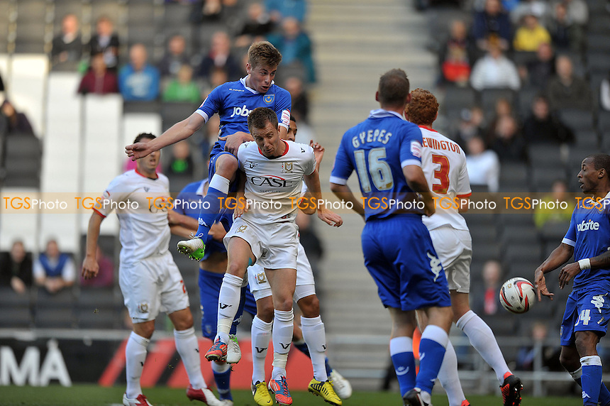 Adam Webster of Portsmouth gets a header in at goal. - MK Dons vs Portsmouth - NPower League One Football at Stadium MK, Milton Keynes - 06/10/2012 - MANDATORY CREDIT: Martin Dalton/TGSPHOTO - Self billing applies where appropriate - 0845 094 6026 - contact@tgsphoto.co.uk - NO UNPAID USE.