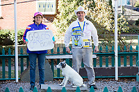 Carlos Arredondo, 57, (right) and his wife Melida Arredondo, 52, are seen in their front yard in Roslindale, Boston, Massachusetts, USA, on Sat., March 31, 2018. Arredondo is well known as the &quot;man in the cowboy hat&quot; who helped out in the aftermath of the Boston Marathon Bombing in 2013. Carlos is wearing a jacket that he has used to create a t-shirt design for when he runs the Boston Marathon later this year. Though he has run the race unofficially previously, this will be the first time he runs it &quot;legally,&quot; he says. <br /> <br /> Their dog, Buddy, age 18, can also be seen. Carlos says he often accidentally calls Buddy by his son's name, Brian. Brian Arredondo died by suicide in 2011 after a battle with depression following the 2004 death of Arrendondo's other son  Marine Lance Corporal Alexander Scott Arredondo, who was killed while serving in Iraq. <br /> <br /> Behind the couple is a memorial to their two sons.