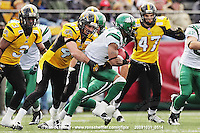 October 31, 2009; Hamilton, ON, CAN;  Hamilton Tiger-Cats linebacker Ray Mariuz (44) tackles Saskatchewan Roughriders wide receiver Jason Armstead (2). CFL football: Saskatchewan Roughriders vs. Hamilton Tiger-Cats at Ivor Wynne Stadium. The Tiger-Cats defeated the Roughriders 24-6. Mandatory Credit: Ron Scheffler. Copyright (c) 2009 Ron Scheffler.