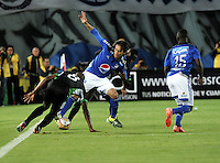 BOGOTA - COLOMBIA -19 – 08 - 2015: Rafael Robayo (Cent.) jugador de Millonarios disputa el balón con Juan Guaza (Izq.) y Helibelton Palacios (Der.) jugadores de Deportivo Cali, durante partido entre Millonarios y Deportivo Cali por la fecha 7 de la Liga Aguila II 2015, jugado en el estadio Nemesio Camacho El Campin de la ciudad de Bogota. / Rafael Robayo (C) player of Millonarios Fe vies for the ball with Juan Guaza (L) and Helibelton Palacios (R) players of Deportivo Cali during a match Millonarios and Deportivo Cali for date 7 of the Liga Aguila II 2015 at the Nemesio Camacho El Campin Stadium in Bogota city. Photo: VizzorImage  / Luis Ramirez / Staff.