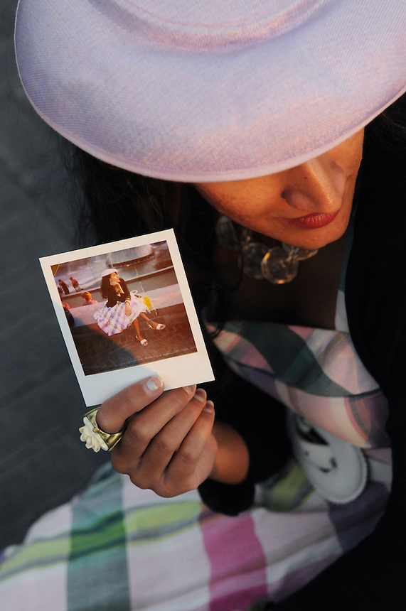 Jayita Sahni of Santa Fe, Calif. holds a Polaroid photo depicting the vintage dress, cardigan and hat she wore to the 2011 Bumbershoot music and arts festival in Seattle Center on Monday, September 5, 2011.